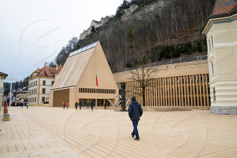 The central street of the city with typical buildings business center Vaduz Liechtenstein. photo