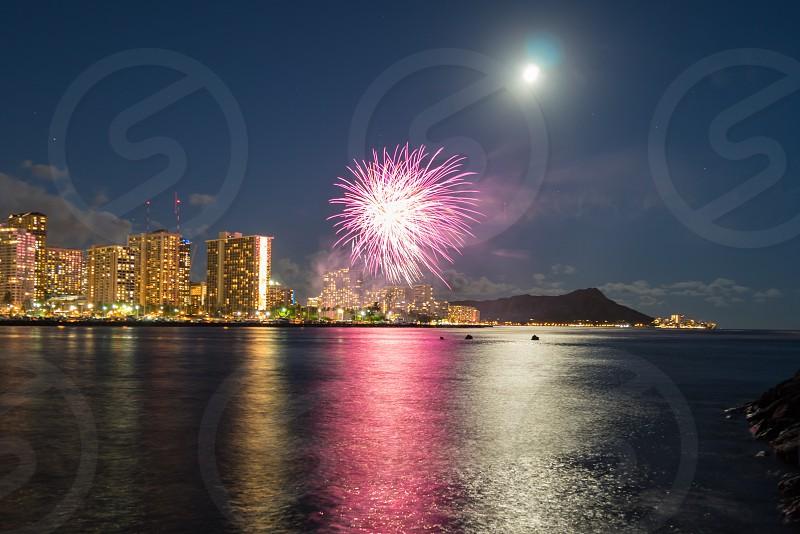 Hawaii magic island Oahu Honolulu fireworks vacation travel diamond Head shillouette ocean water downtown  photo