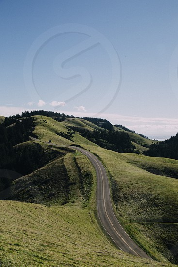 areal photography of road near mountain photo