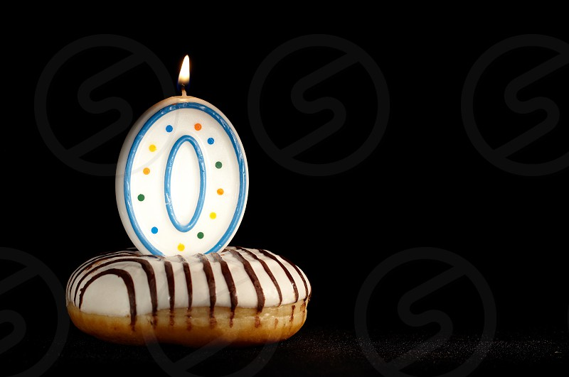 Candle 0 in the doughnut. Birthday background or the new beginnings concept. photo