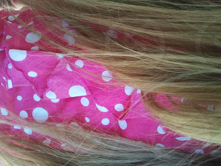 Blond hair on a dotty bluse photo