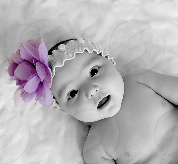 Baby with a bow.  photo