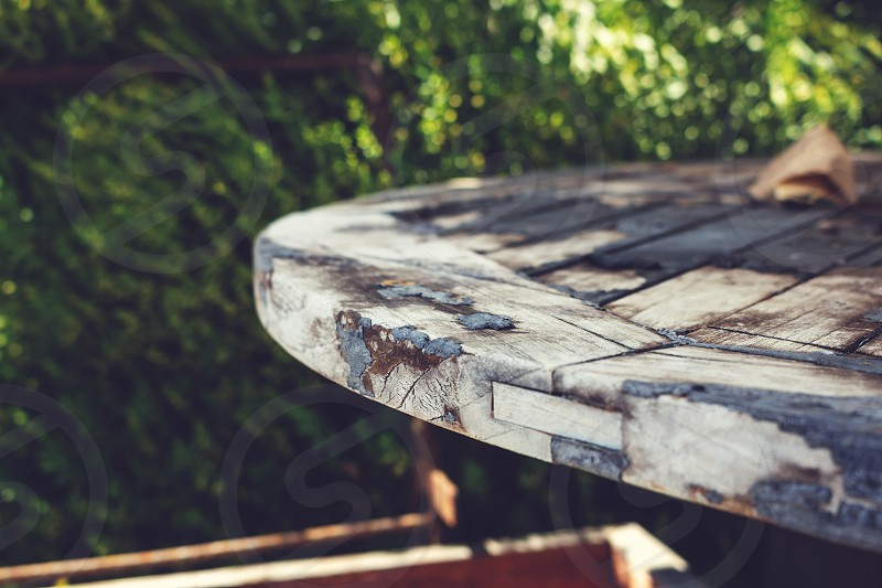 A rustic wooden patio table in the garden photo