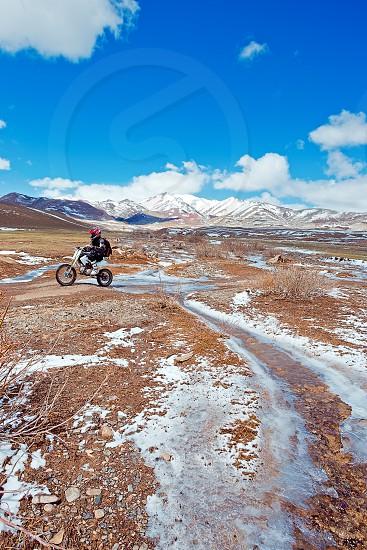 Motorbikes on the road in mountains Russia Siberia Altai photo