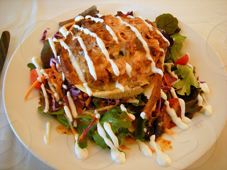 Salad with quiche on top photo