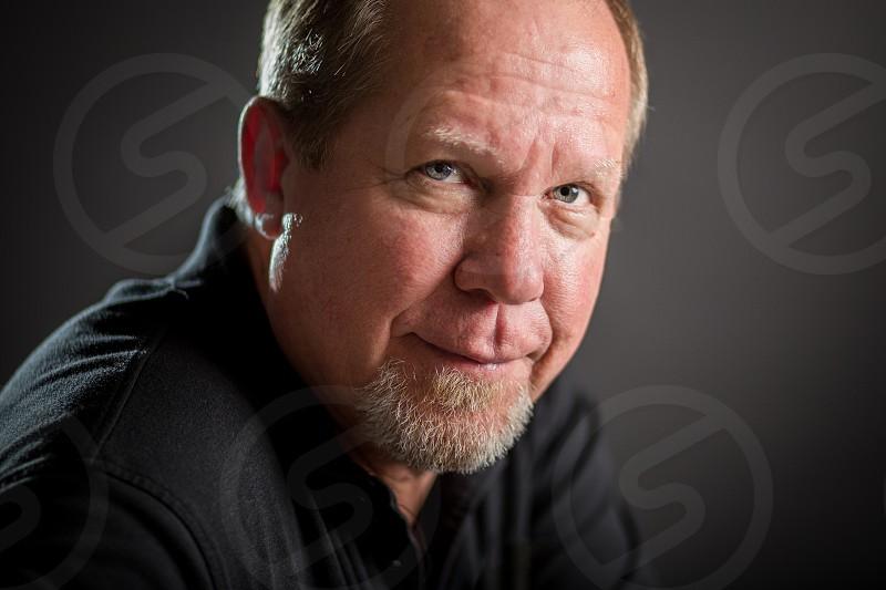 Studio portrait of a middle-aged man photo