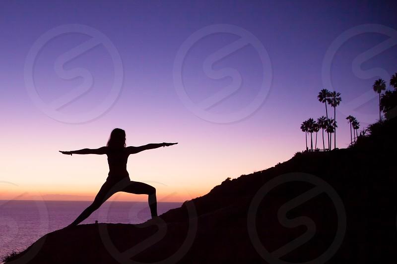 Yoga beach sunset silhouette photo