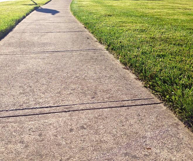 sidewalk near grass photo