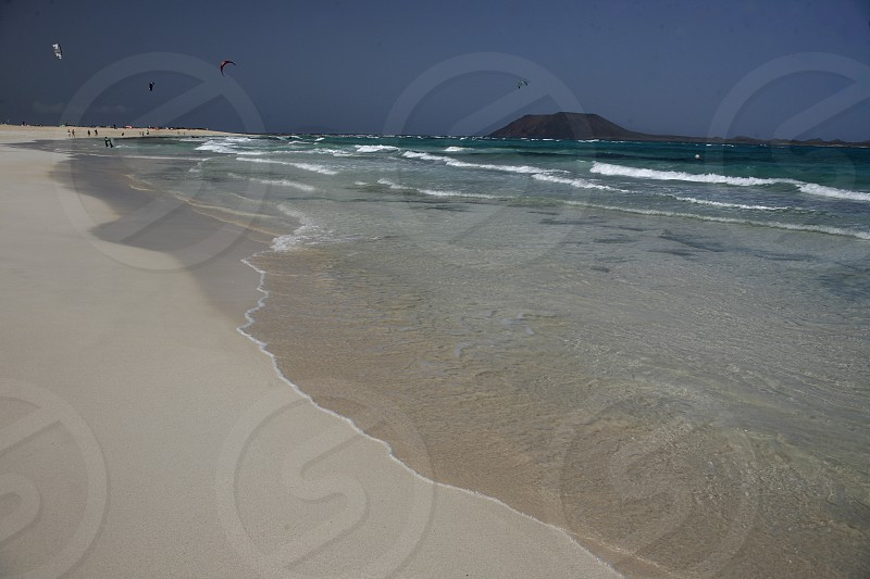 the Beach of  Corralejo on the Island Fuerteventura on the Canary island of Spain in the Atlantic Ocean. photo