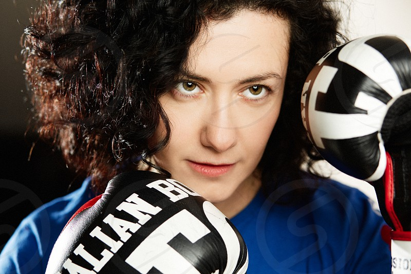 Curly woman with boxing gloves photo