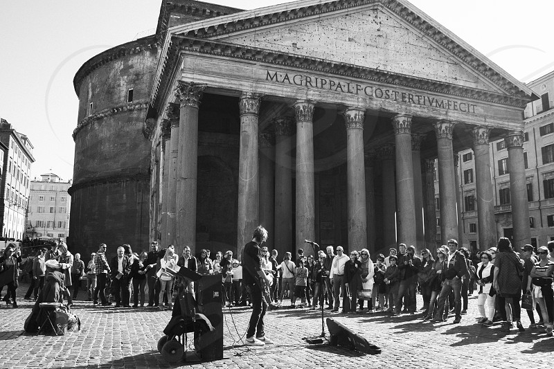 Audience listening street musician in Rome photo