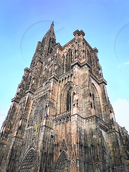 Main entrance of Roman Catholic Cathedral Notre Dame of Strasbourg in Alsace France. Beautiful sunny day with clear blue sky. Majestic gothic architecture. photo