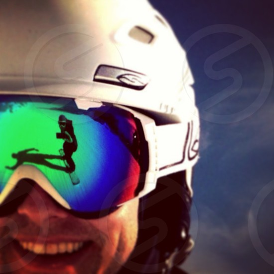 men's white ice ski helmet  photo