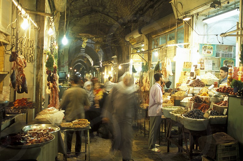 shops in the market or souq in the old town in the city of Aleppo in Syria in the middle east photo