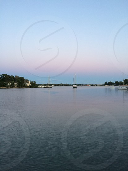 white sailboats on water at daytime photo