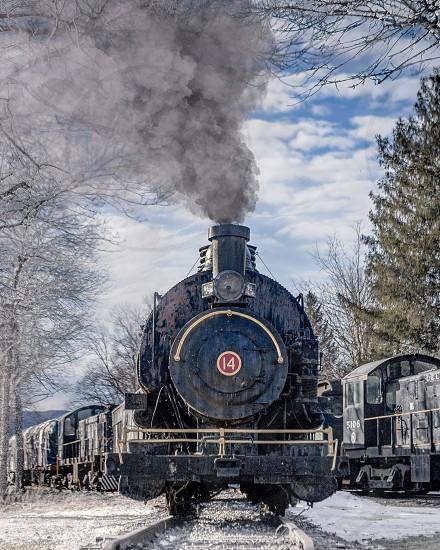Vintage steam engine locomotive train in winter photo