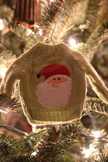 miniature green knit sweater with santa claus fabric patch ornament photo