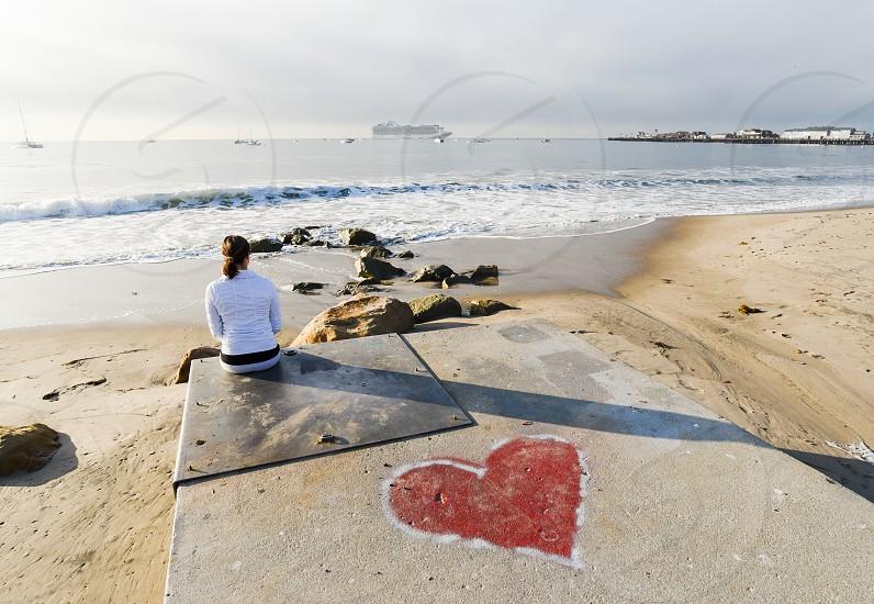 love heart ocean reflect woman pier santa barbara beach photo