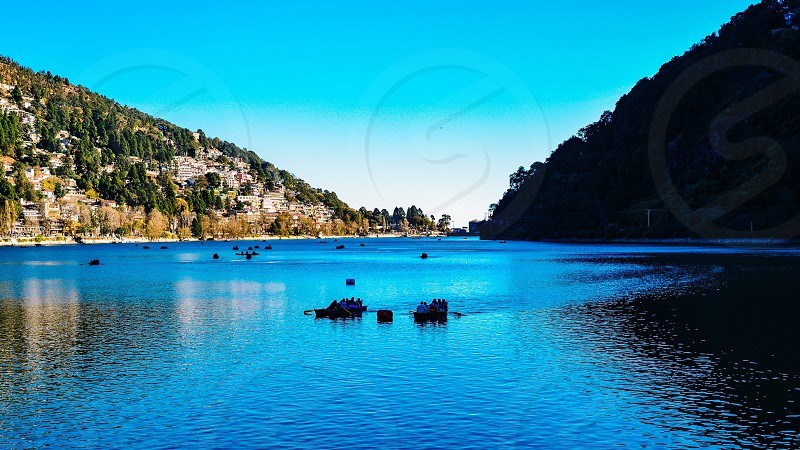 Mountains lake lake in the mountains valley nature landscape wilds boating in the lake  photo
