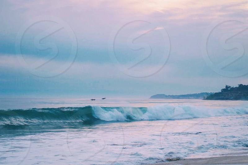 Dawn patrol Malibu beach waves California photo