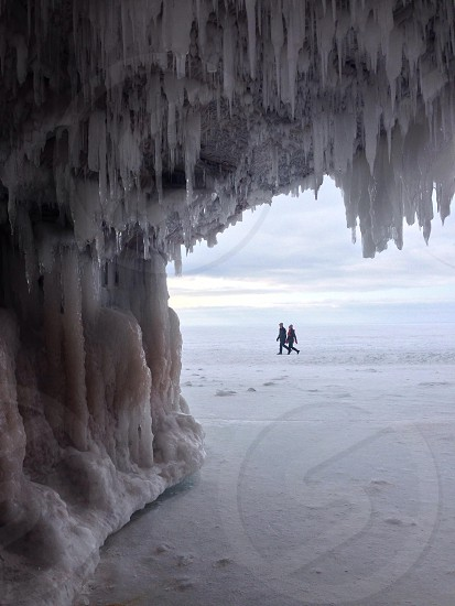 couple passing icicles photo