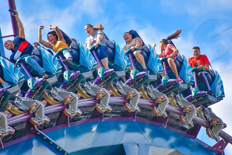 Orlando Florida . February 17  2019  People enjoying Mako Rollercoaster on lightblue cloudy sky background in International Drive area (8) photo