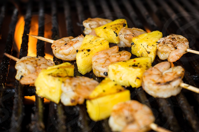 Shrimp and Pineapple Skewers Cooking on the Grill photo