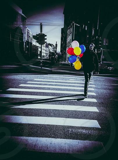 Outdoor day vertical colour colourpop black and white grainy crossing road balloon balloons  photo