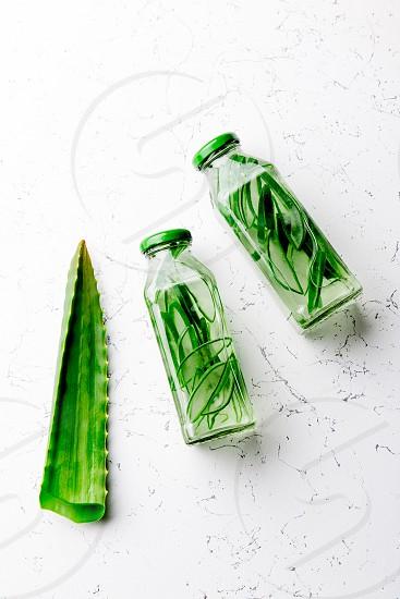 Detox water with aloe vera. Healthy drink. Top view. photo