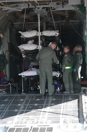 Transporting patients on military plane photo