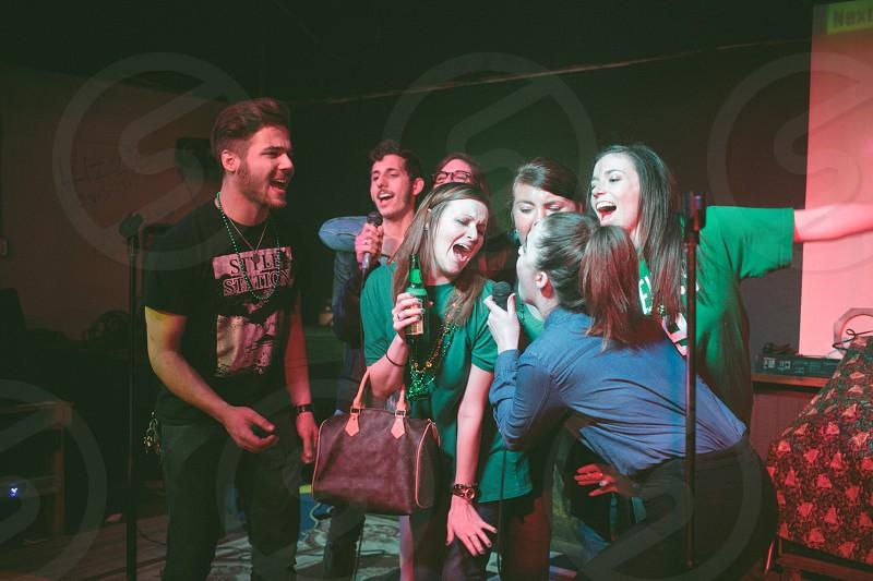 men and women singing photo