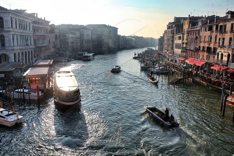 Venezia  Italy transportation  trip tour boat gondolas people sunlight  travel winter city architecture  season water  photo