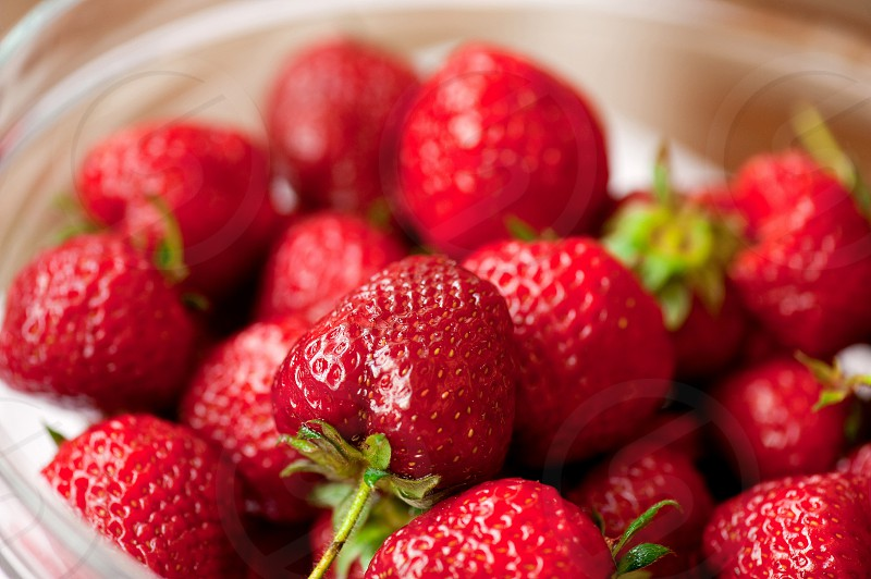 red strawberries in a glass bowl photo