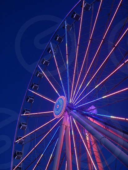 white and pink LED ferris wheel photo
