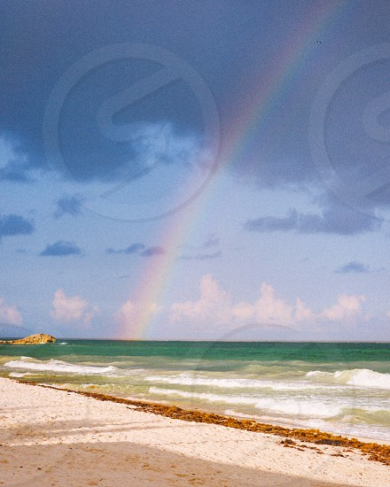 Rainbow water ocean sea clouds beach photo