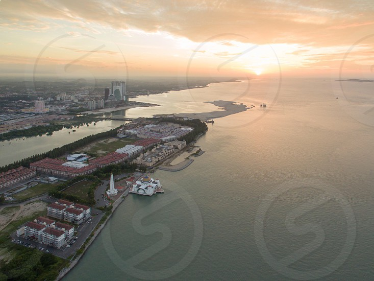 areal photography of city buildings near calm body water photo