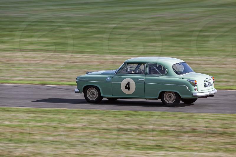 GOODWOOD WEST SUSSEX/UK - SEPTEMBER 14 : Vintage Racing at Goodwood at Goodwood on September 14 2012. One unidentified person photo
