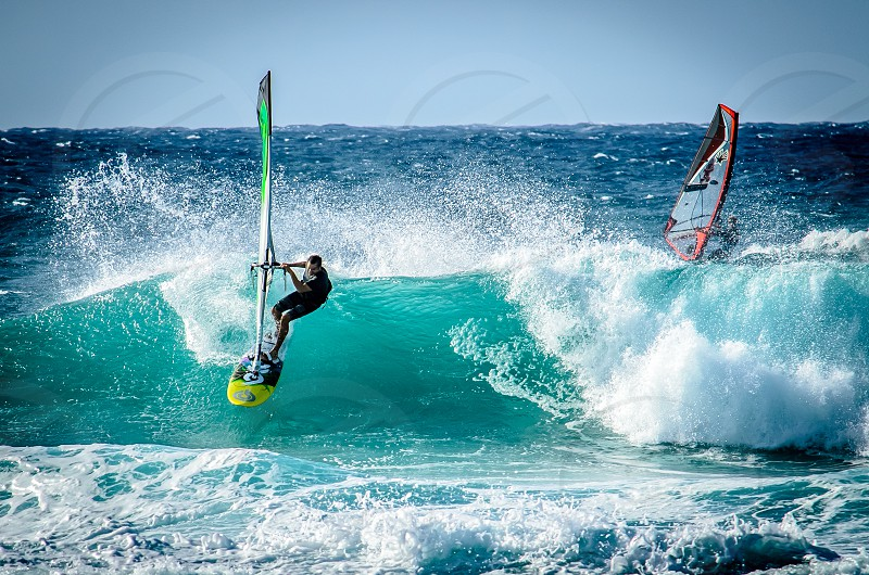 Surfers showing of on the waves on Maui Hookipa photo