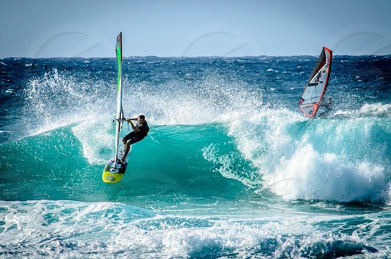 surfers having fun surfing on maui photo