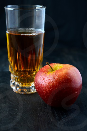 applered juce glass dark background wooden background cold drink food photo