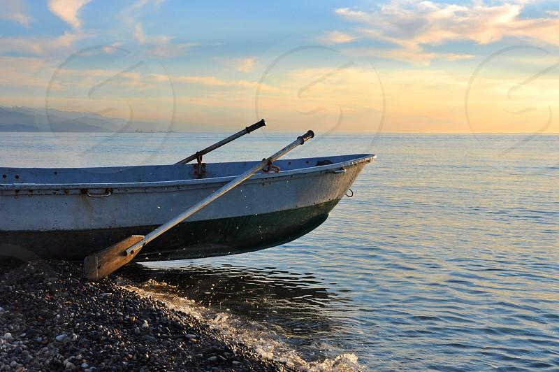 boat on the seashore photo