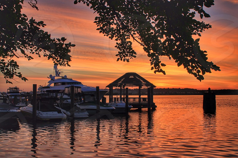boats on water during a sunset photo