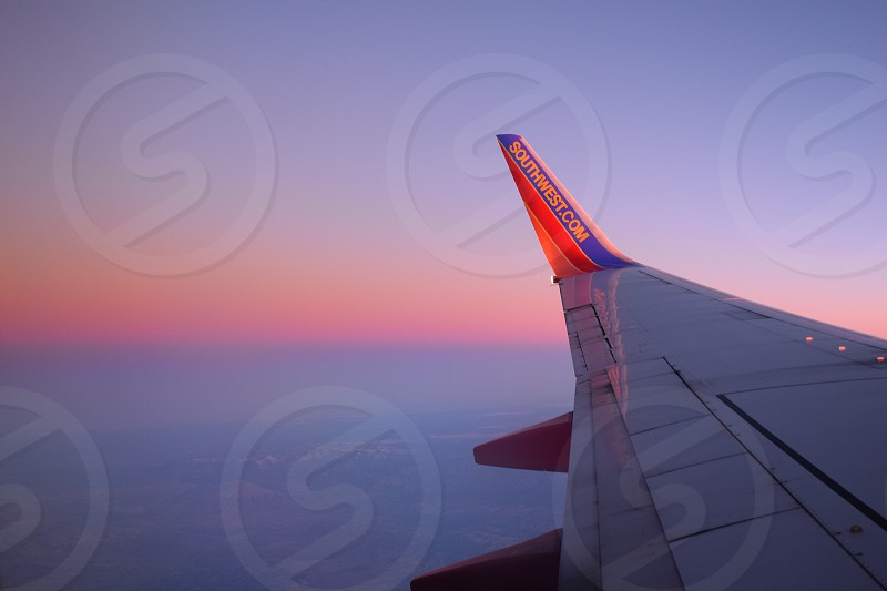 shallow photography of airplane wing photo