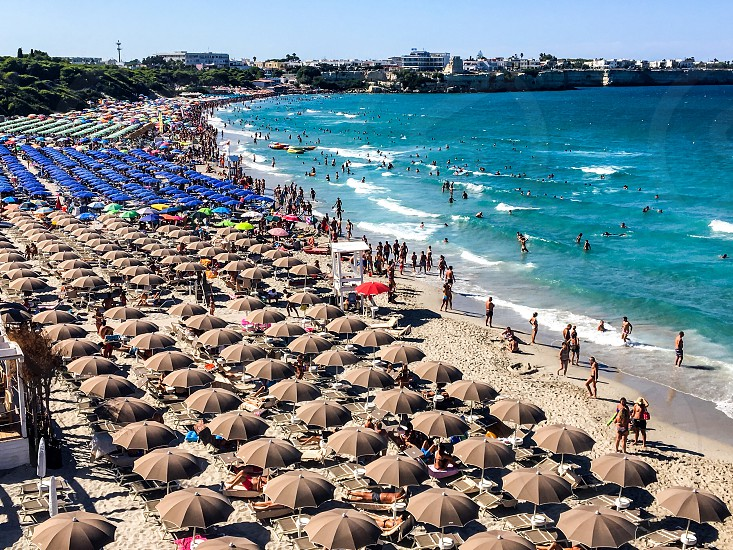Torre dell'orso Puglia south Italy beach crowded sunbathing bird's eye view photo