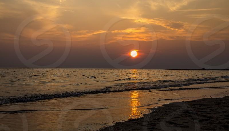 Sky clouds sun sunset beach water nature  photo