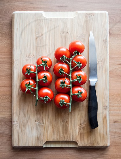 Close-up of tomatoes on a wooden desk in the kitchen photo
