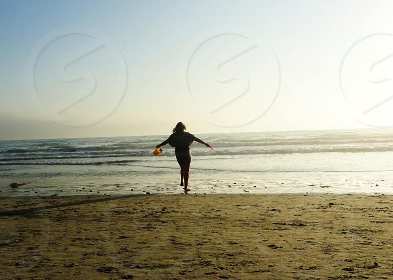 woman standing on the sand photo