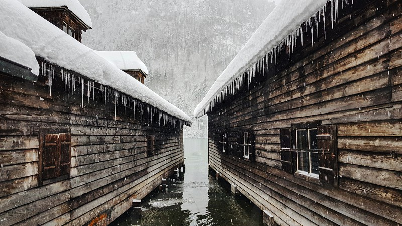 Wooden boathouses on a lake. photo