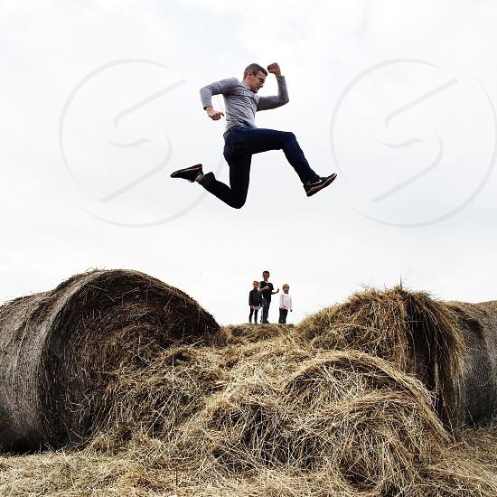 Hay bales family jump fun. photo
