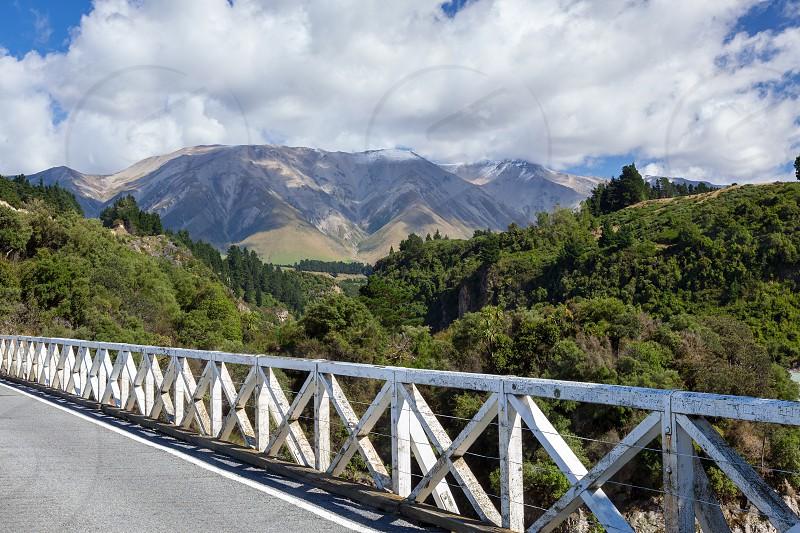 RAKAIA RIVER CANTERBURY PLAINS/NEW ZEALAND - FEBRUARY 25 : View from the Rakaia Gorge bridge in  New Zealand on February 25 2012 photo